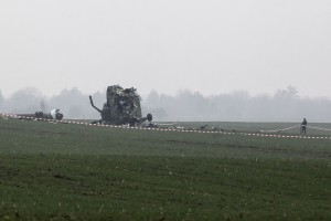 A Serbian army soldier stands next to the wreckage of a military helicopter near Belgrade airport